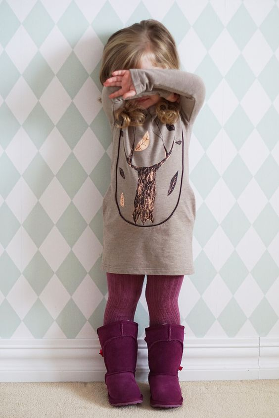 purple tall suede boots and tights of the same shade, a neutral dress with a tree printed