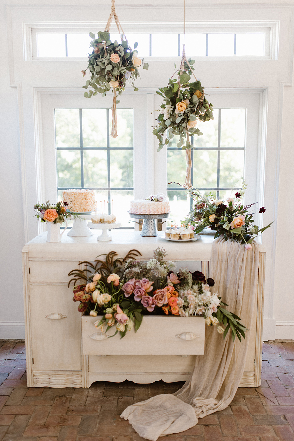 dessert table with flowers - photo by Lindsay Hackney Photography http://ruffledblog.com/the-ultimate-garden-lover-bridal-inspiration