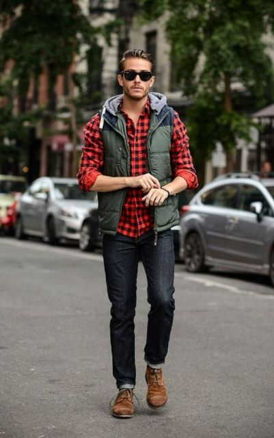 With plaid shirt, cuffed jeans and brown boots