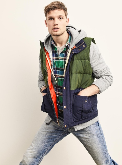 With plaid shirt, hooded sweatshirt and jeans