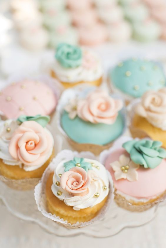 cupcakes with mint and peach flower frosting
