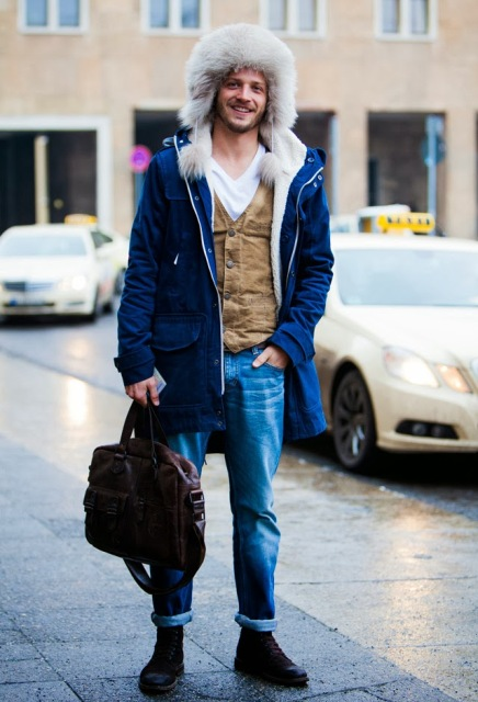 With white t-shirt, suede vest, cuffed jeans and fur hat