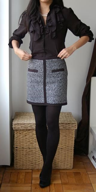 a tweed mini skirt and a black ruffled blouse for a monochrome look