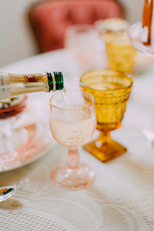 Champagne in pink depression glass | GingerSnap Photography