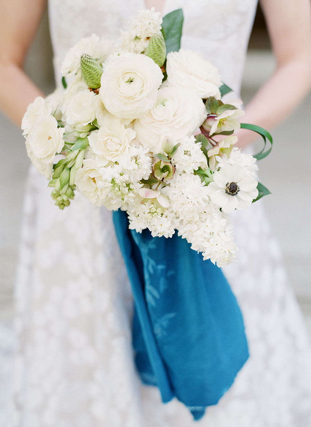 white bouquet with pops of green - photo by Lisa Blume Photography http://ruffledblog.com/cyanotype-inspired-wedding-ideas