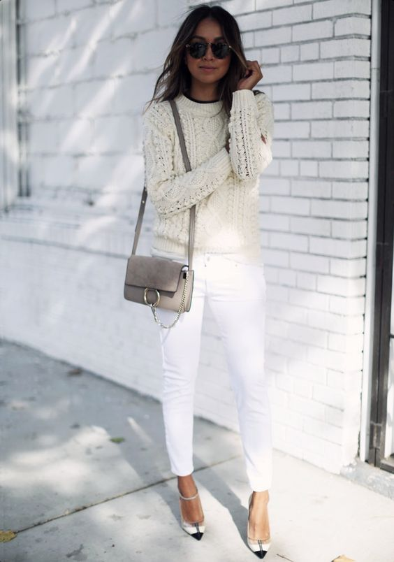a cable knit ivory sweater, white jeans and heels