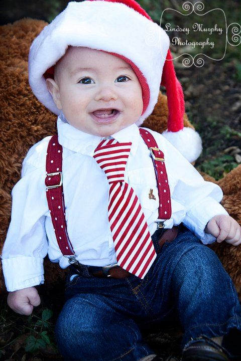 jeans, a shirt, a tie, suspenders and a red Santa hat