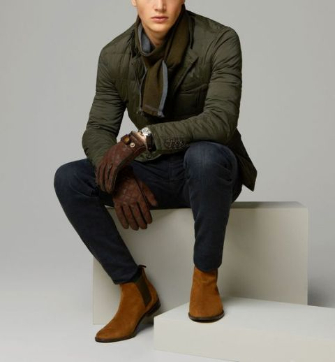 With green army jacket, brown gloves and jeans