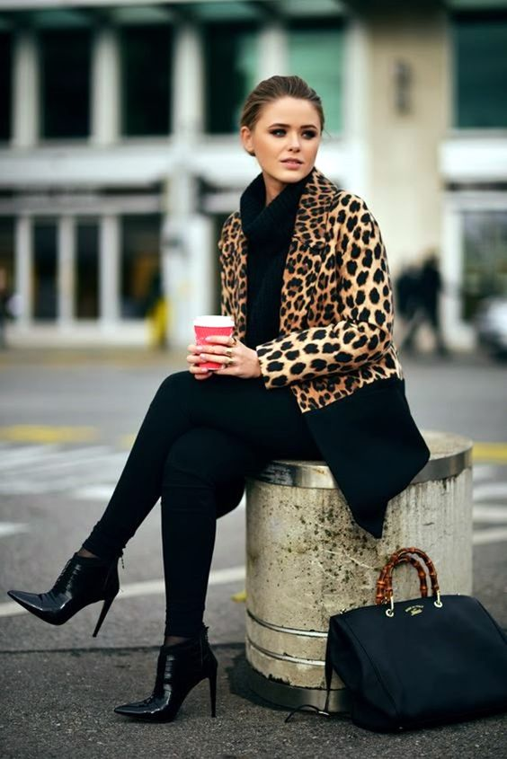 total black look with pants, a turtleneck sweater and heels and an animal print coat