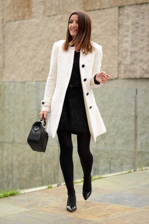 a patterned black mini dress, a white coat and black heels for a timeless look