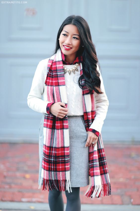a cable knit sweater, a grey skirt and a plaid sscarf
