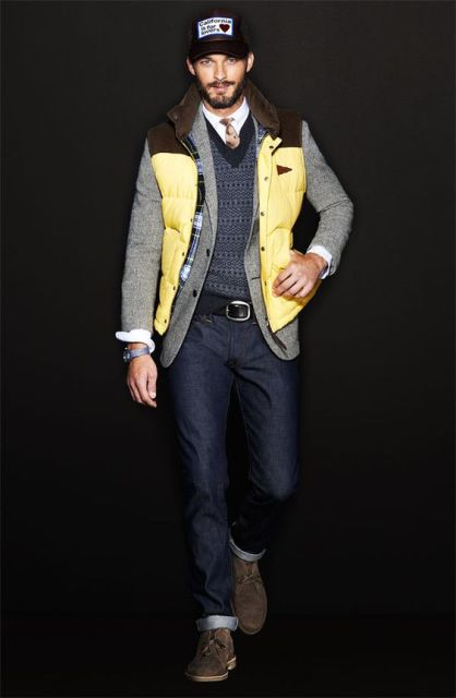 With cuffed jeans, white shirt, tie, printed sweater, jacket and cap