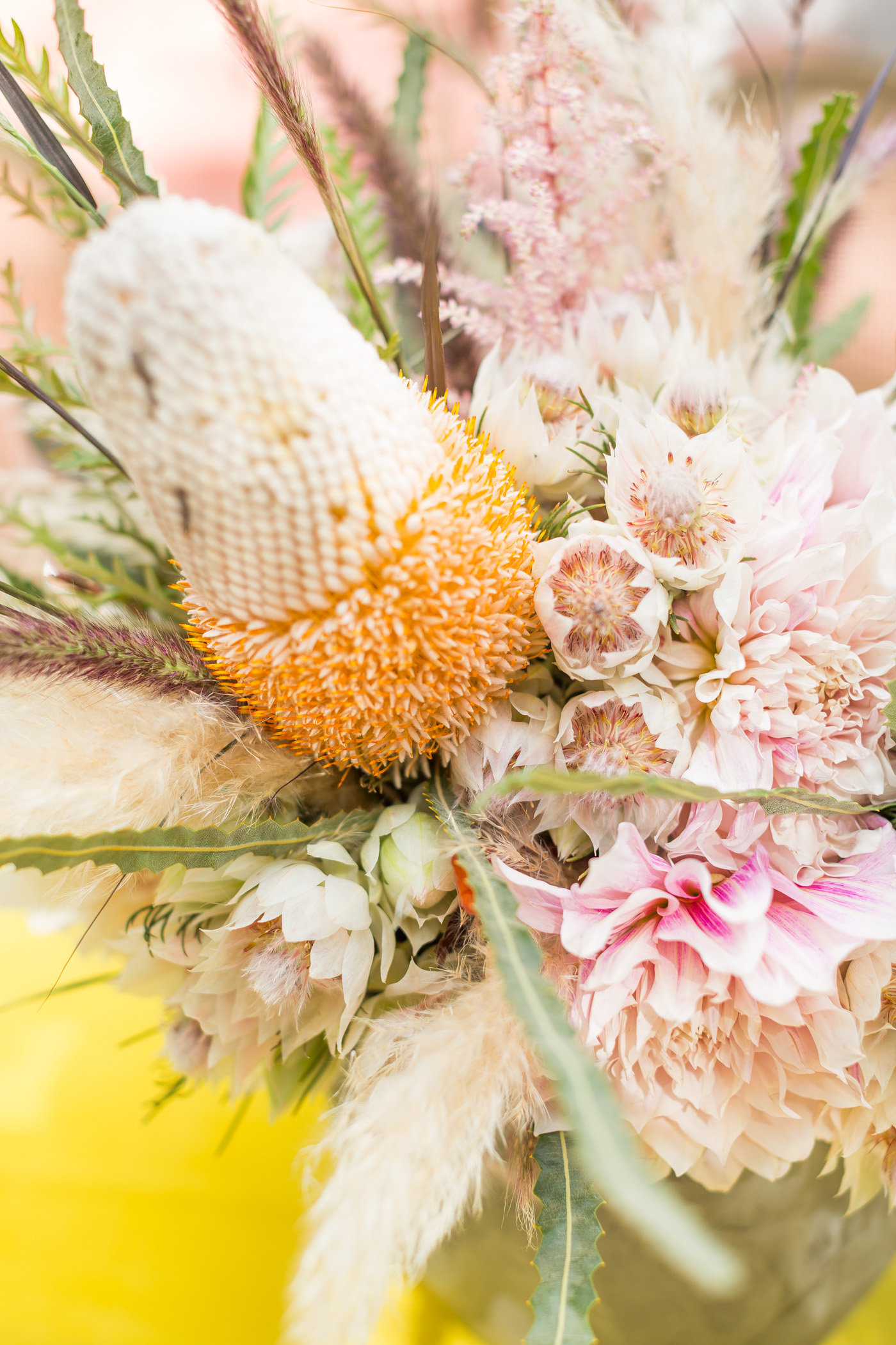 king protea floral arrangements - photo by Karlee K Photography http://ruffledblog.com/cheerful-desert-wedding-inspiration-with-bright-yellow