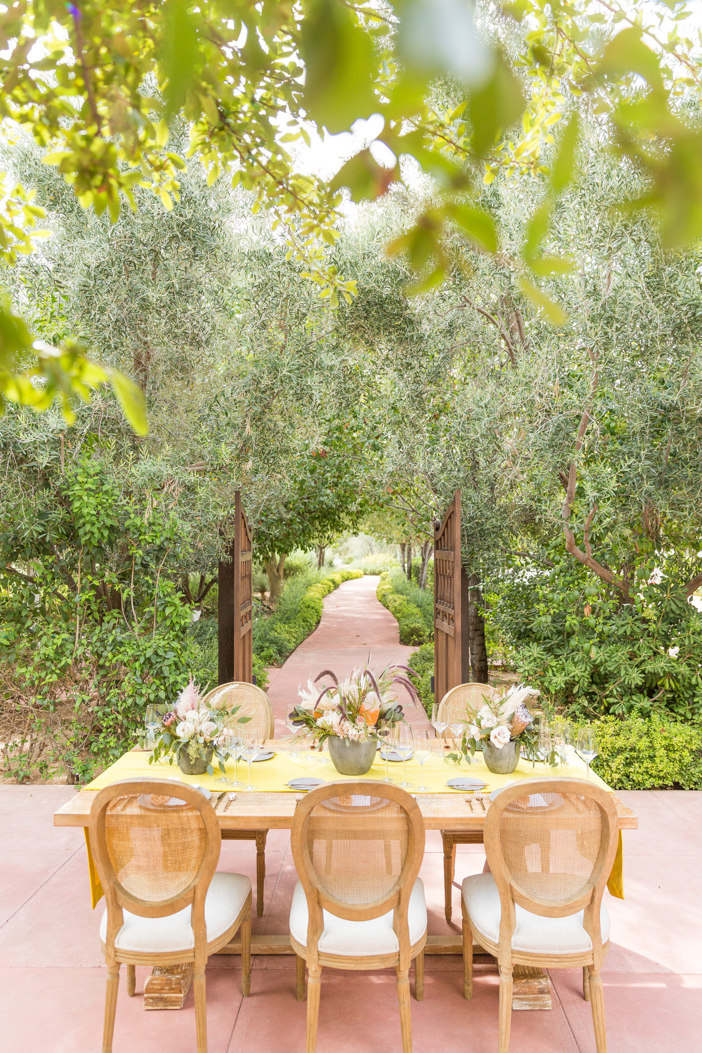 summer wedding tables - photo by Karlee K Photography http://ruffledblog.com/cheerful-desert-wedding-inspiration-with-bright-yellow