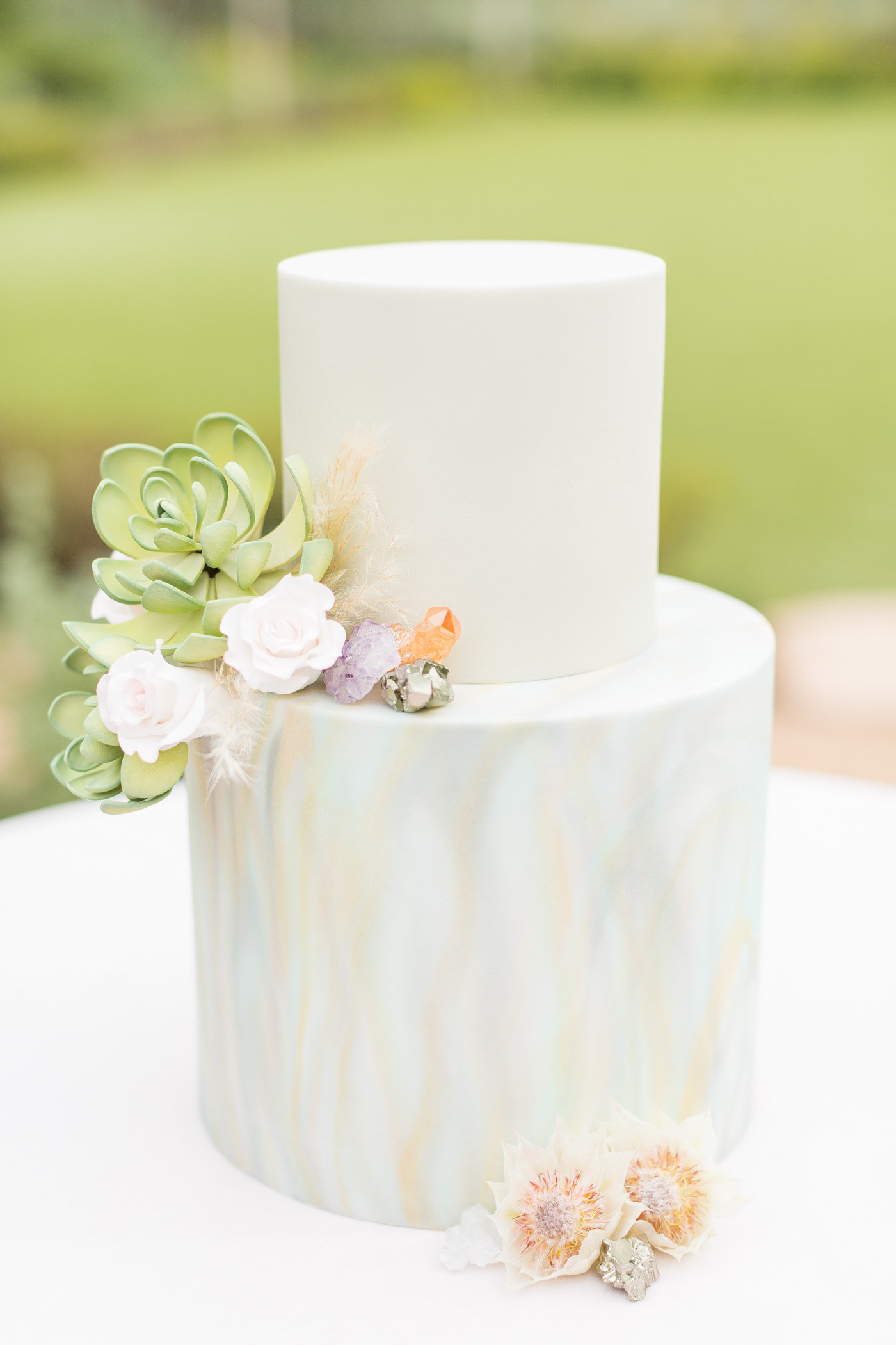 wedding cake with marbled effect - photo by Karlee K Photography http://ruffledblog.com/cheerful-desert-wedding-inspiration-with-bright-yellow