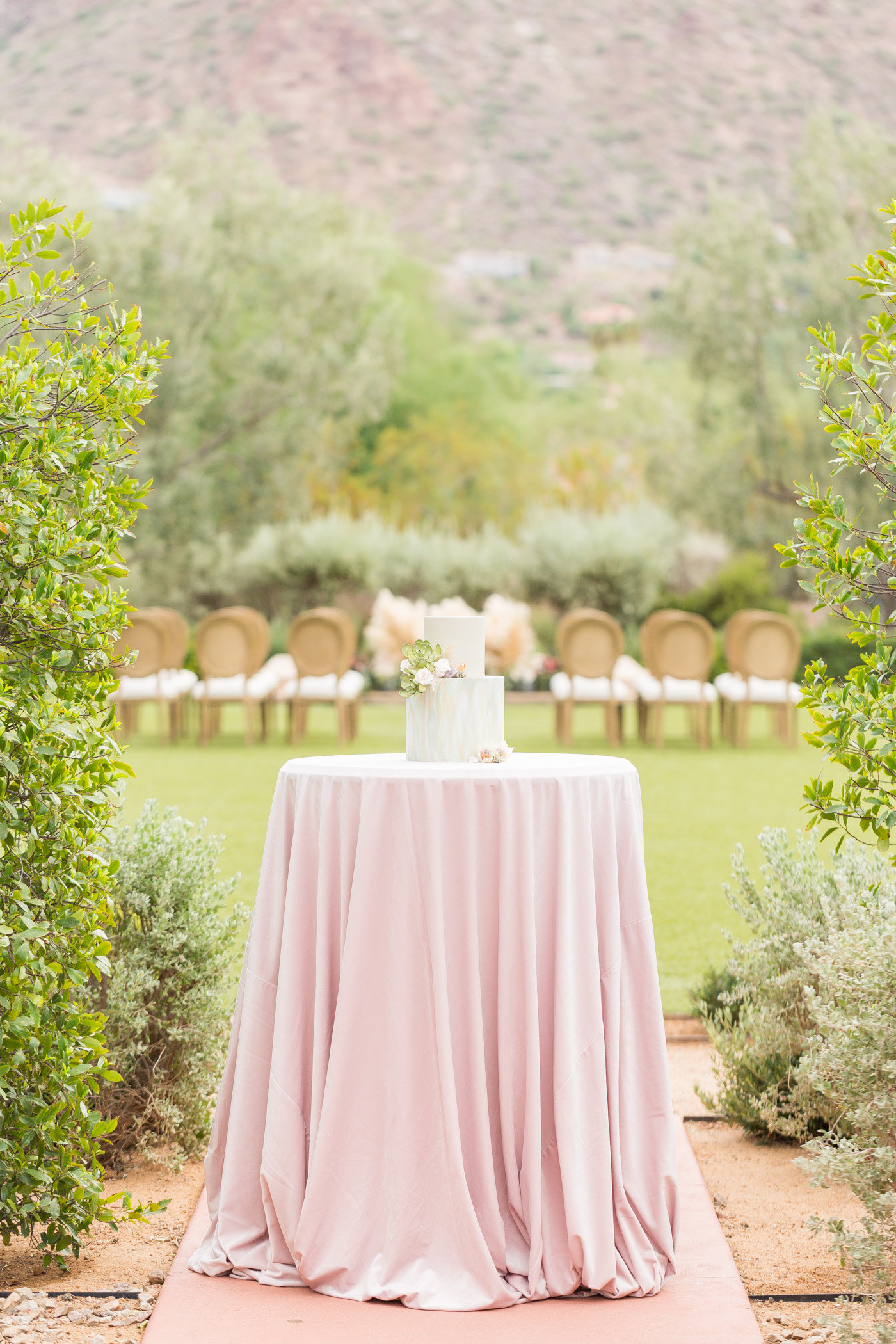cake table - photo by Karlee K Photography http://ruffledblog.com/cheerful-desert-wedding-inspiration-with-bright-yellow