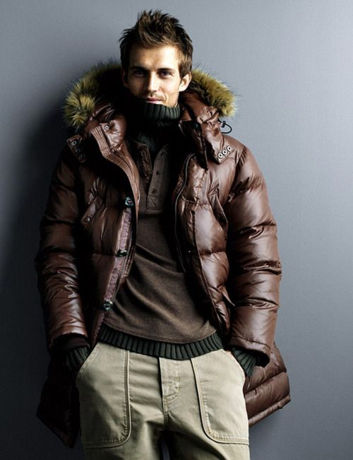 beige pants, a brown sweater, a brown quilted parke coat
