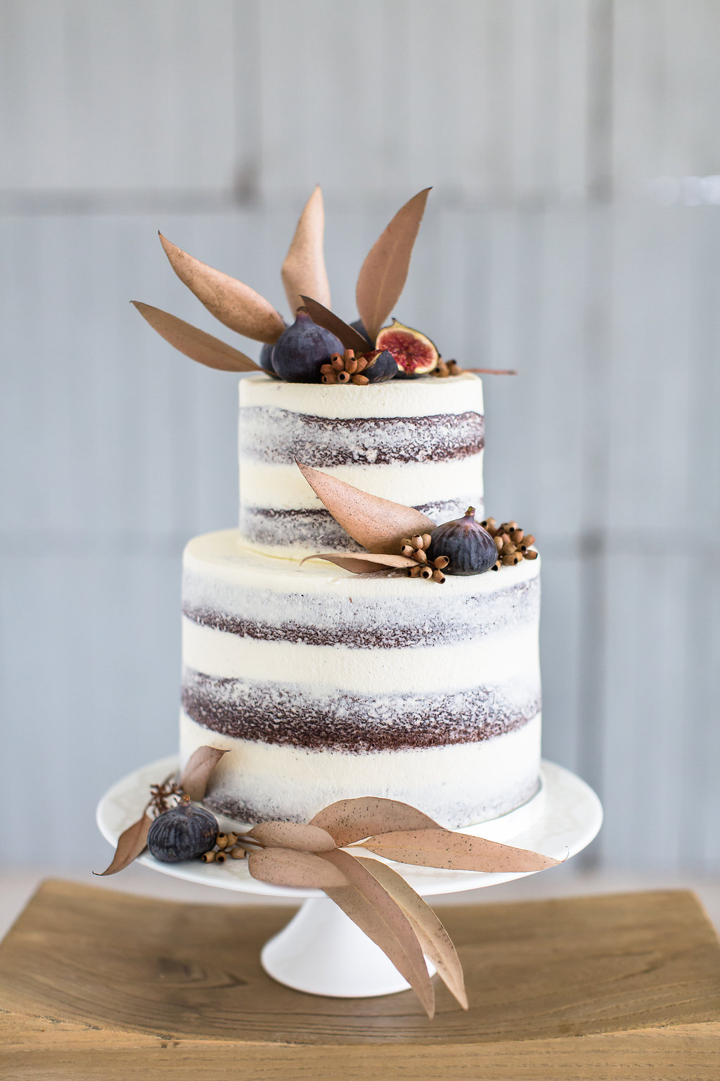 wedding cake with figs - photo by Wesley Vorster http://ruffledblog.com/modern-chic-boho-fall-wedding-inspiration