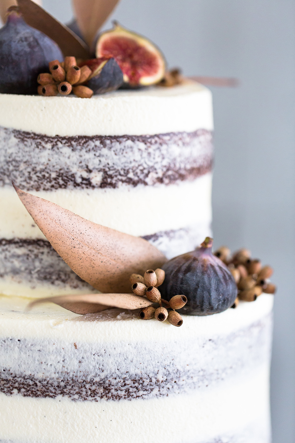wedding cakes with fruit - photo by Wesley Vorster http://ruffledblog.com/modern-chic-boho-fall-wedding-inspiration