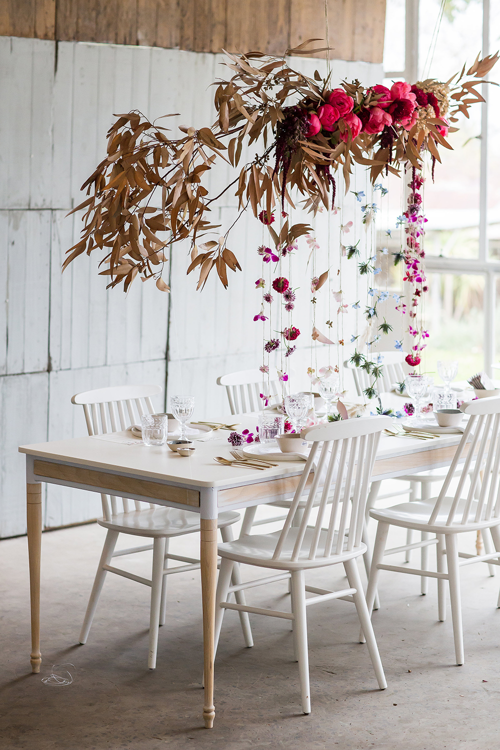 hanging floral arrangements with leaves - photo by Wesley Vorster http://ruffledblog.com/modern-chic-boho-fall-wedding-inspiration