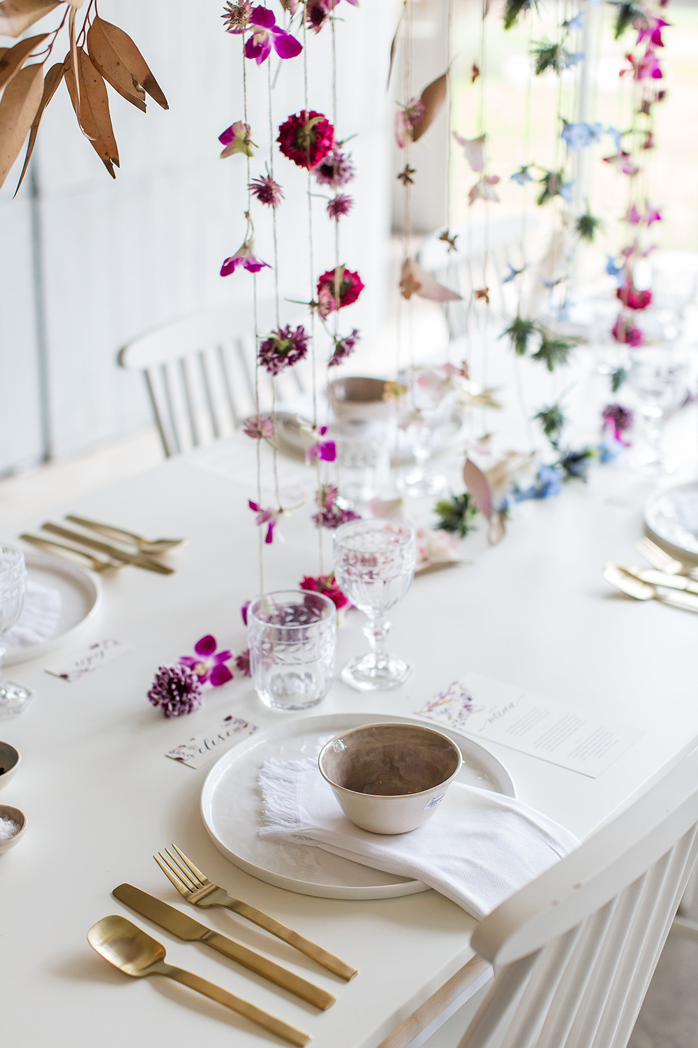 hanging floral arrangements - photo by Wesley Vorster http://ruffledblog.com/modern-chic-boho-fall-wedding-inspiration
