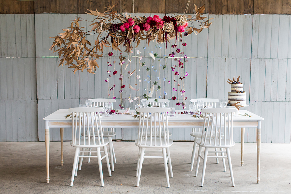 white wedding tables - photo by Wesley Vorster http://ruffledblog.com/modern-chic-boho-fall-wedding-inspiration