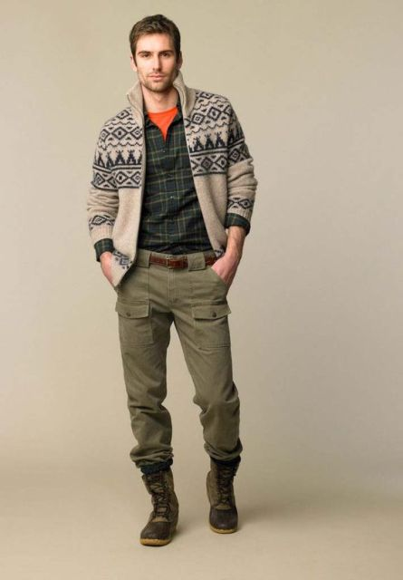 With orange t-shirt, plaid shirt, printed sweater and green army pants