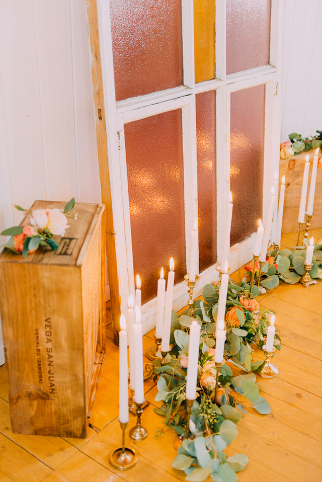 Vintage stained glass and candles wedding ceremony backdrop | GingerSnap Photography
