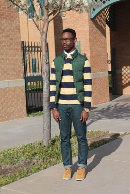 With striped sweater, jeans and sneakers