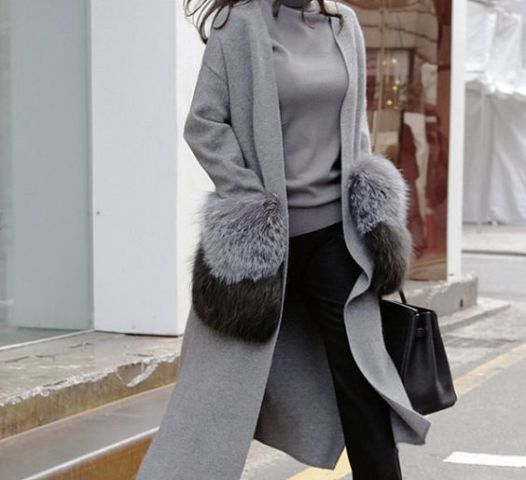 With gray sweater, black trousers and classic bag