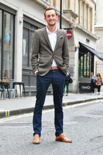 With gray jacket, navy blue pants, leather belt and white button down shirt
