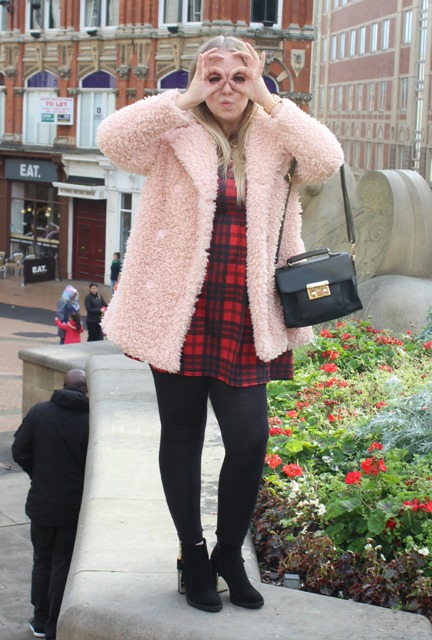 With plaid dress, black tights and ankle boots