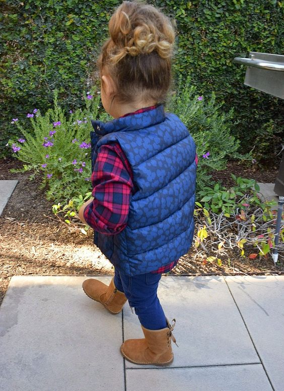 blue jeans, a puff vest, a plaid shirt and suede boots