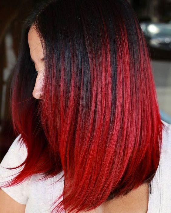 black hair with fiery red balayage