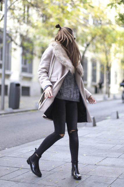 With gray loose shirt, distressed jeans and mid calf boots