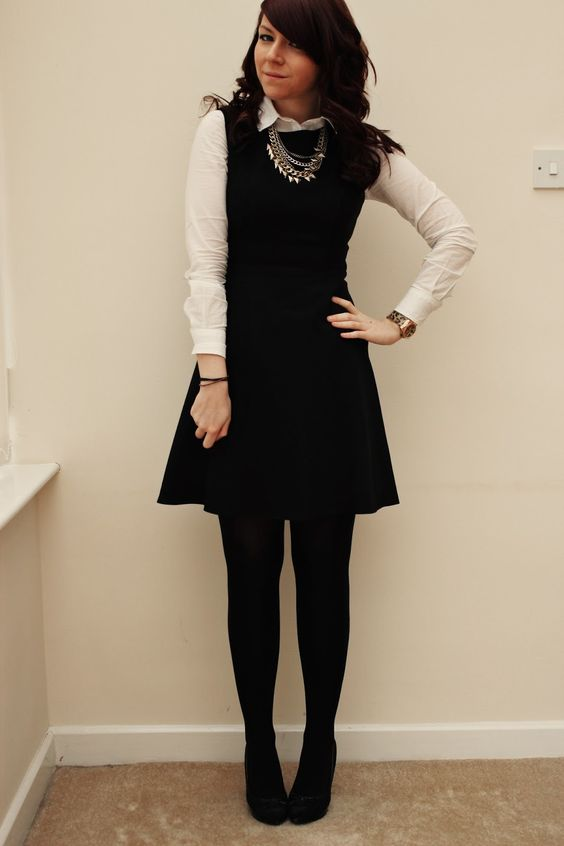 a button down under a sleeveless dress with tights