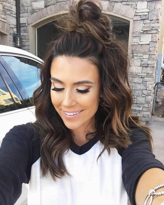 half up top knot hair is a popular option for medium and long hair