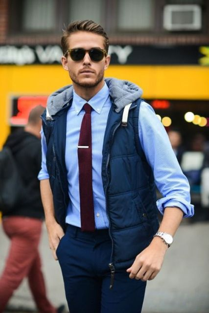 With blue button down shirt, marsala tie and navy blue trousers