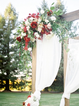 Floral decor for wedding ceremony arbor   Love in Photographs