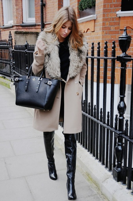 With black shirt, skinnies, over the knee leather boots and big bag