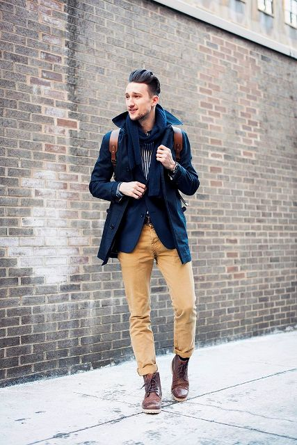 With navy blue blazer, light brown cuffed pants and mid calf boots