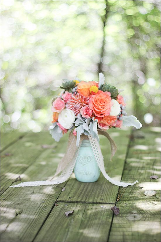 mint mason jar centerpiece with peach and pink flowers