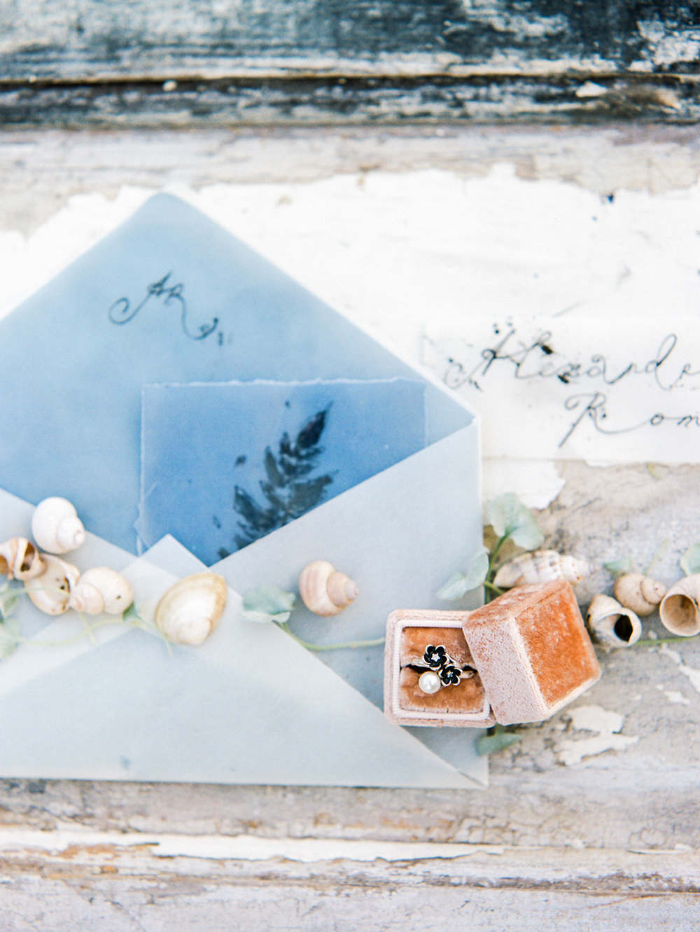 blue invitation envelopes - photo by Muravnik Photography http://ruffledblog.com/calming-baltic-sea-wedding-inspiration