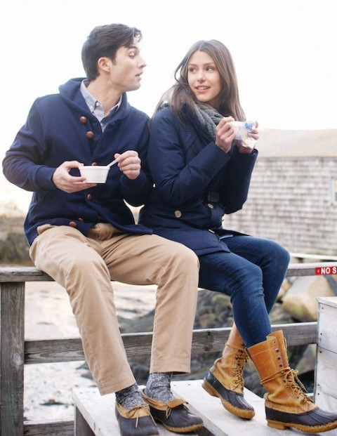 With shirt, navy blue coat and camel pants