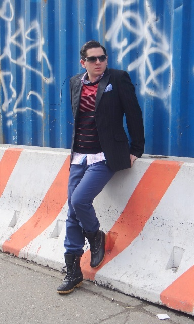 With striped sweater, blue trousers and black jacket