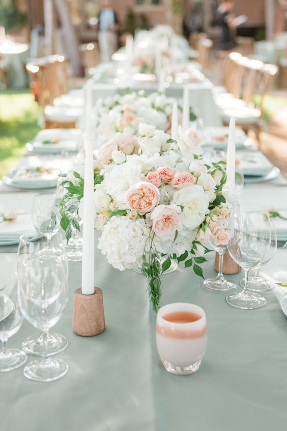 mint tablecloth, peach roses and candles and beautiful ivory touches to refresh the look