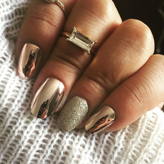 copper metallic nails with a silver glitter accent nail