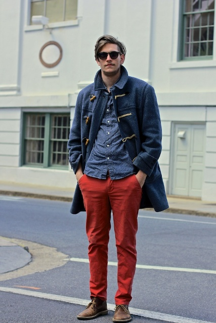 With patterned shirt, red pants and brown shoes
