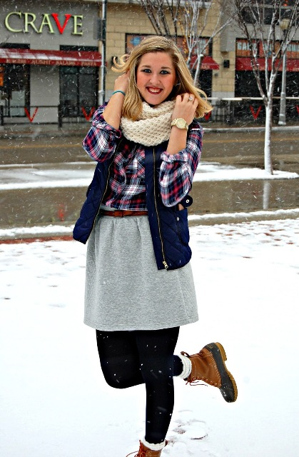 With plaid shirt, puffer vest, knitted scarf and gray skirt