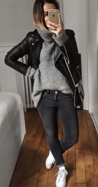 black jeans, a grey chunky knit sweater, white sneakers and a black leather jacket